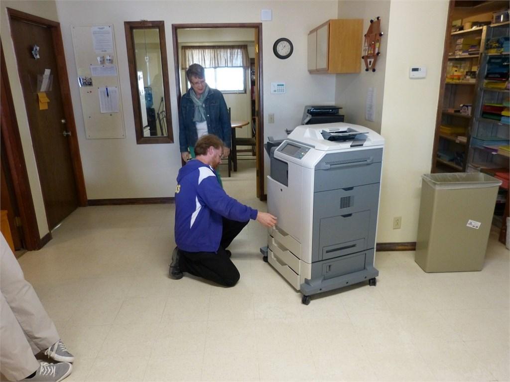 Media Director Ray Kishen checking out printer
