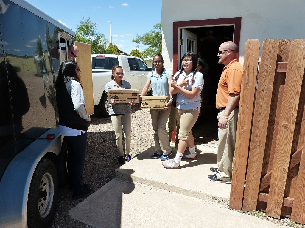 Native American Christian Academy students helping Randy unload food